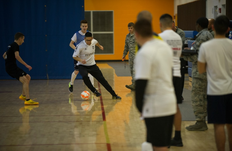 An Airman from the 5th Medical Group controls the ball during the intramural indoor soccer championship at Minot Air Force Base, N.D., Nov. 24, 2015. The game between the 5th MDG and 5th Contracting Squadron resulted in a win for 5th CONS. (U.S. Air Force photo/Senior Airman Apryl Hall)