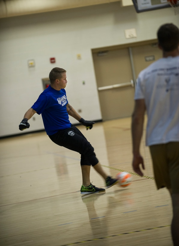 Senior Airman Rian Praleikas, 5th Medical Support Squadron, kicks the ball during the intramural indoor soccer championship at Minot Air Force Base, N.D., Nov. 24, 2015. Praleikas played goalie for the 5th Medical Group team, which ended up losing the game to the 5th Contracting Squadron. (U.S. Air Force photo/Senior Airman Apryl Hall)