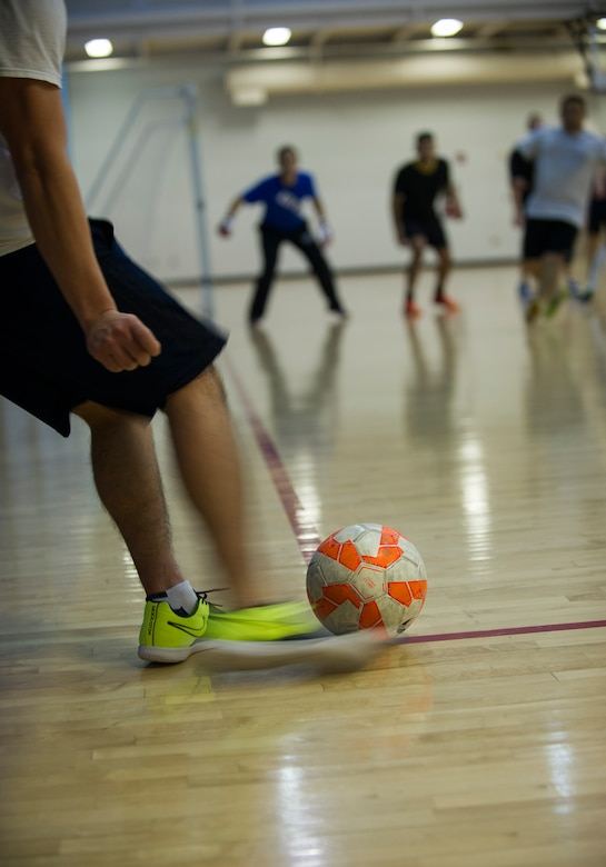 An Airman from the 5th Medical Group takes a corner kick during the intramural indoor soccer championship at Minot Air Force Base, N.D., Nov. 24, 2015. The game between the 5th MDG and 5th Contracting Squadron resulted in a win for 5th CONS. (U.S. Air Force photo/Senior Airman Apryl Hall)