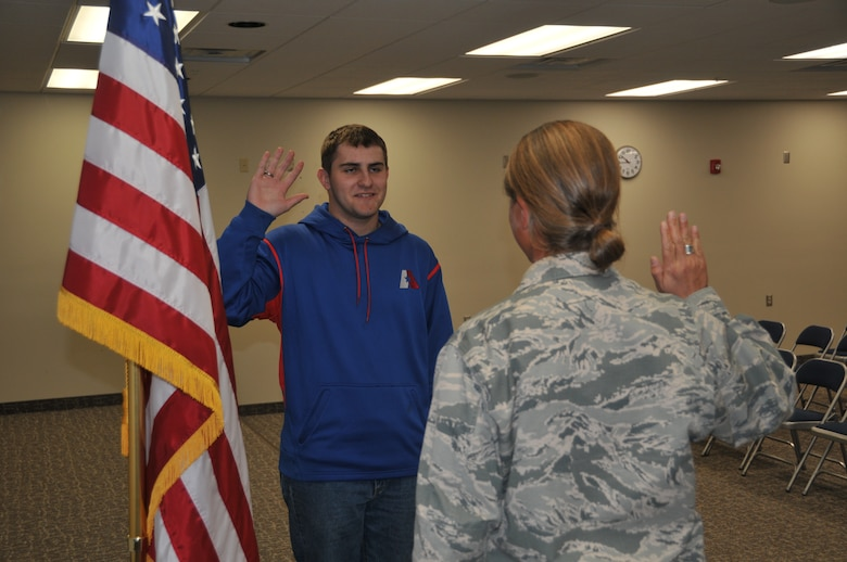120th Logistics Readiness Squadron Commander Lt. Col. Jennifer Cinq-Mars administers the oath of enlistment to Eric Fletcher in the Larsen Room of the 120th Airlift Wing Headquarters Building on Oct. 30, 2015. (U.S. Air National Guard photo by Senior Master Sgt. Eric Peterson/Released)