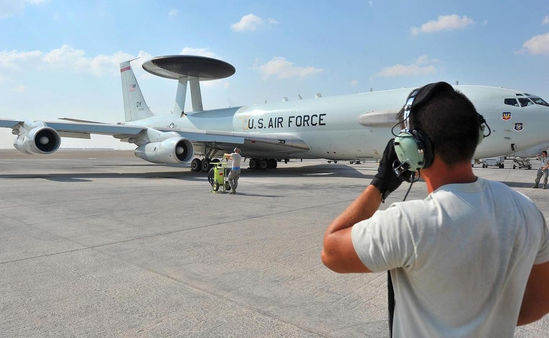 Maintainers from the 380th Air Expeditionary Squadron prep the E-3G Sentry airborne warning and control system aircraft for its first-ever combat sortie from an undisclosed location Southwest Asia, Nov. 20, 2015. The E-3G is the newest model of Sentry aircraft to be recently completed as part of the AWACS modernization program. (U.S. Air Force photo by Staff Sgt. Kentavist P. Brackin)