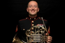 Cpl. Aaron Atwood poses for a photograph holding his French Horn Nov. 5, at Marine Recruiting Station Springfield's Headquarters. The 27-year-old Danbury, Connecticut-native used his Post 9/11 G.I. Bill to obtain a Bachelor's of Music Performance Classical French Horn from Western Connecticut State University. Atwood has reenlisted into the Marines so that he can have a career as a full time preforming musician. He will be with the Marine Band stationed in New Orleans, La. (Official Marine Corps photo by Staff Sgt. Richard Blumenstein).