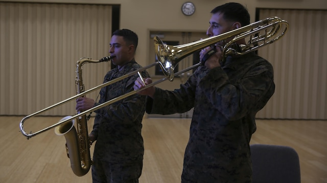 Staff Sgt. Alexander Panos, a trombone player with the 1st Marine Division Band, rehearses alongside his fellow Marines aboard Marine Corps Base Camp Pendleton, Nov. 23, 2015. Panos was recognized as the Marine Corps Musician of the Year Award for 2015