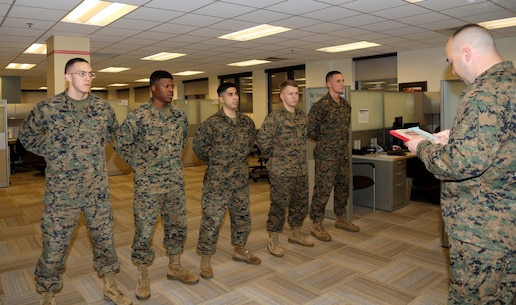 Several Marines recently performed temporary duty with the Program and Resources Department, Transportation Voucher and Certification Branch, Marine Corps Logistics Command.  Their combined efforts resulted in processing over 3,000 Marine household goods moves claim reimbursements totaling more than 5.6 million dollars to Marines and their families.  From left to right, CWO2 Geoffrey Collver reads a Letter of Appreciation to Sgt Aaron J. Scott, MCRD Paris Island, Beaufort, SC; Sgt Courtland T. Williams, 3rd Marine Logistics Group, Okinawa, JP;   Cpl Austin C. Ackel, 2nd Marine Logistics Group, Camp Lejeune, NC; LCpl Timothy J. Soushekstevenson, MCRD Paris Island, Beaufort, SC;   and LCpl Jacob K. Haddad, 2nd Marine Logistics Group, Camp Lejeune, NC.