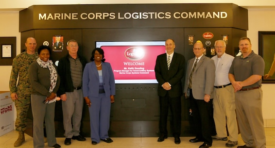 Mr. Keith Gooding, Program Manager and Mr. Mark Smith, Product Support Manager for Towed Artillery Systems (TAS), Marine Corps Systems Command, visited MARCORLOGCOM on 01 December 2015. Weapon Systems Management Center hosted the visit which also included a tour of Marine Depot Maintenance Command, Production Plant Albany.