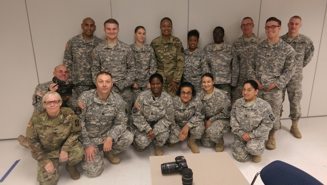 """Army Reserve Soldiers from various units under the 807th Medical Command (Deployment Support) pose for a photo during the Unit Public Affairs Representative training held at Segoville, Texas, Nov. 30, 2015. """"The Soldier is the greatest asset in telling the Army story,"""" said Staff Sgt. Erik Fardette, public affairs noncommissioned officer with the 807th MCDS. """"Training like this provides commanders at all levels an organic and valuable asset in branding their unit and Army Reserve name."""" (U.S. Army photo by Staff Sgt. Kai L. Jensen, 807th Medical Command (Deployment Support))"""