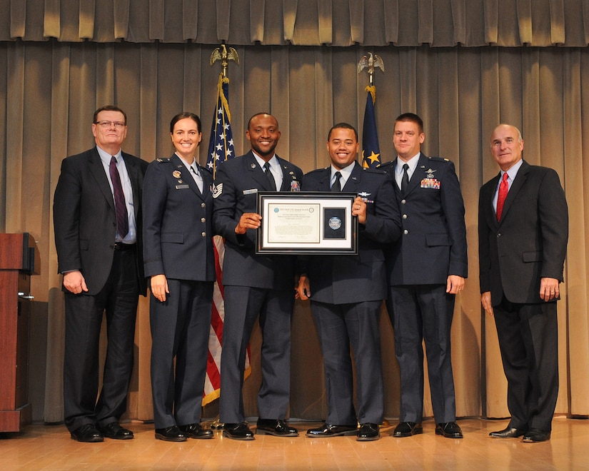 The Defense Department's Chief Information Officer Terry Halvorsen, left, poses with members of the Air Force Information Network Mission Assurance Center Development Team, which won a team award at the 2015 Department of Defense Chief Information Officer Award for Cyber and IT Excellence at the Pentagon, Washington, D.C., Dec. 1, 2015. U.S. Army photo by EboniEverson-Myart