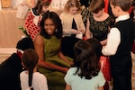 First Lady Michelle Obama talks with guests while hosting military family members at the White House to give them a look at 2015 holiday decorations and treat preparation, Dec. 2, 2015. DoD photo by EJ Hersom