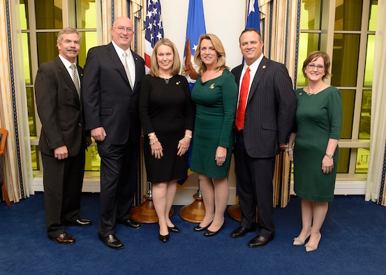 Secretary of the Air Force Deborah Lee James stands with, from left, John Wood, chairman of the TAPS board; David Coker, president of the Fisher House Foundation; Bonnie Carroll, founder of TAPS; Brian Gawe, vice president for Fisher House community relations; and TAPS member Ellen Andrews. (U.S. Air Force photo/Scott M. Ash)