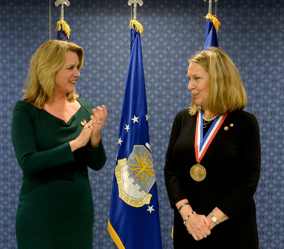 Secretary of the Air Force Deborah Lee James congratulates Bonnie Carroll, the founder and president of the Tragedy Assistance Program for Survivors, during a ceremony honoring Carroll with the Zachary and Elizabeth Fisher Distinguished Civilian Humanitarian Award in the Pentagon, Dec. 1, 2015. (U.S. Air Force photo/Scott M. Ash)