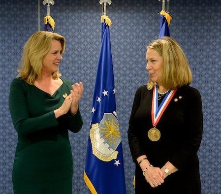 Secretary of the Air Force Deborah Lee James congratulates Bonnie Carroll, the founder and president of the Tragedy Assistance Program for Survivors, during a ceremony honoring Carroll with the Zachary and Elizabeth Fisher Distinguished Civilian Humanitarian Award in the Pentagon Dec. 1, 2015. (U.S. Air Force photo/Scott M. Ash)