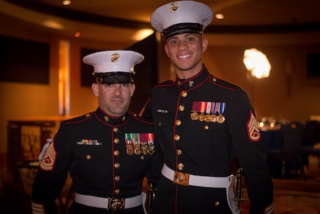 GySgt. Allen Lee (left) and SSgt. Joseph Ford, from the 12th Marine Corps District Supply Office, pose for pictures before performing in the sword detail at the 12th MCD's ball ceremony in San Diego, Ca. Nov. 6 2015. The Marine Corps Ball celebrates the birth of the Marine Corps and is a unifying tradition held by Marine commands all over the world. (U.S. Marine Corps photo provided by SSgt. Joseph Ford)