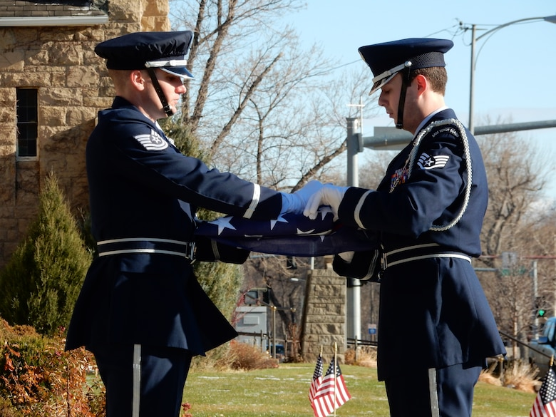120th Airlift Wing Base Honor Guard members Tech. Sgt. Quinn Nelson and Staff Sgt. Trevor Livingston practice folding a flag prior to performing military funeral honors Nov. 19, 2015. (U.S. Air National Guard photo by Senior Master Sgt. Eric Peterson/Released)