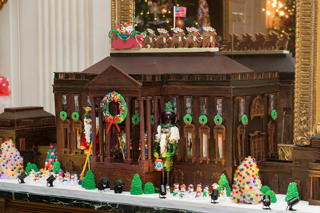 A display shows the annual White House Gingerbread House during an event honoring military families at the White House in Washington, D.C., Dec. 2, 2015. The gingerbread house weighs close to 500 pounds, including more than 250 pounds of gingerbread dough, 150 pounds of dark chocolate, 25 pounds of gum paste, 25 pounds of pulled and sculpted sugar work and 25 pounds of icing. DoD photo by EJ Hersom