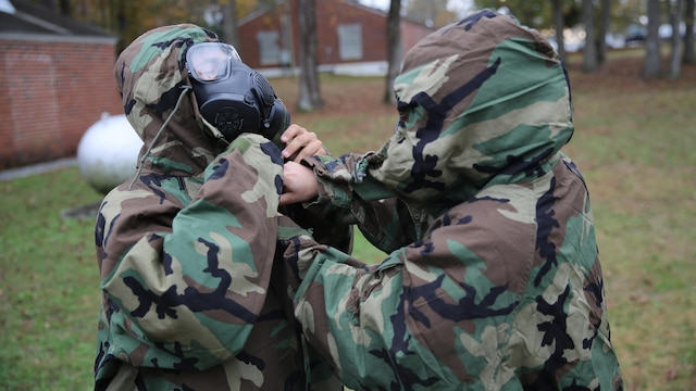 Marines with 2nd Transport Support Battalion check each other for proper wear of their Mission Oriented Protective Posture gear during chemical, biological, radioactive and nuclear defense training held at Marine Corps Base Camp Lejeune, N.C., Dec. 1, 2015. Marines applied information obtained in classes about an active chemical threat and the proper protective equipment to decontaminate themselves in a CBRN situation.
