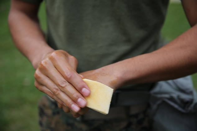 A Marine with 2nd Transport Support Battalion applies a chemical neutralizing agent on his hands during chemical, biological, radioactive and nuclear defense training held at Marine Corps Base Camp Lejeune, N.C., Dec. 1, 2015. Marines applied information obtained in classes about an active chemical threat and the proper protective equipment to decontaminate themselves in a CBRN situation.