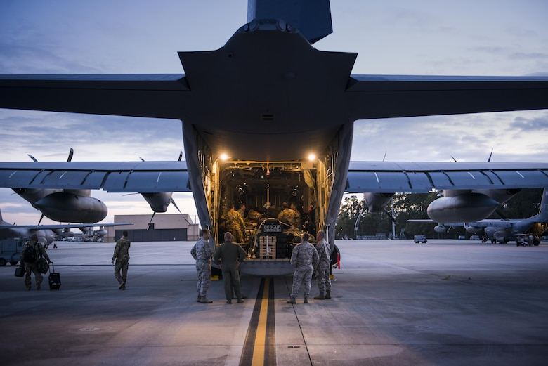 Airmen from the 71st Rescue Squadron secure cargo in the back of an HC-130J Combat King II Nov. 27, 2015, at Moody Air Force Base, Ga. The Airmen deployed in support of Operation Inherent Resolve. (U.S. Air Force photo/Senior Airman Ryan Callaghan)