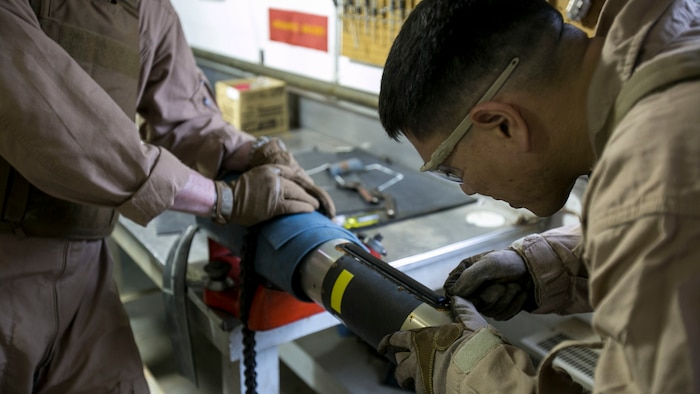 Master Sgt. Jerry Slattum, an Explosive Ordnance Disposal technician with EOD Company, cautiously works on dismantling the Griffin missile to remove the explosives from the missile at Marine Corps Base Camp Lejeune, N.C., Dec. 1, 2015. A Griffin missile is an air and ground-launched, precise, low collateral-damage missile used for irregular warfare operations.