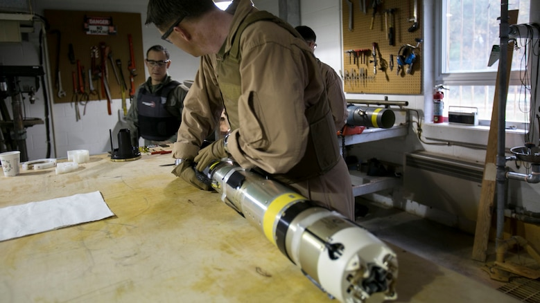 Chief Warrant Officer 2 Jason Scarborough, an Explosive Ordnance Disposal technician with EOD Company, begins to remove the explosive ordnance from the Griffin missile at Marine Corps Base Camp Lejeune, N.C., Dec. 1, 2015. A Griffin missile is an air and ground-launched, precise, low collateral-damage missile used for irregular warfare operations.