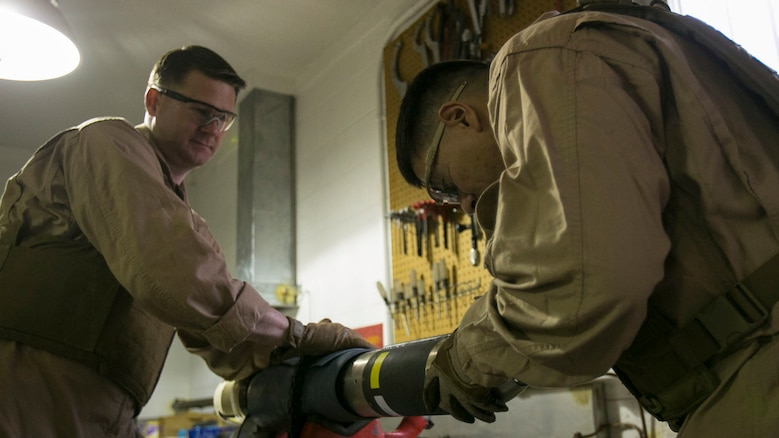 Chief Warrant Officer 2 Jason Scarborough, left, and Master Sgt. Jerry Slattum, Explosive Ordnance Disposal technicians with EOD Company, remove the explosive ordnance from a Griffin missile at Marine Corps Base Camp Lejeune, N.C., Dec. 1, 2015. Marines with EOD constantly work to develop procedures and familiarize themselves with new ordnance.