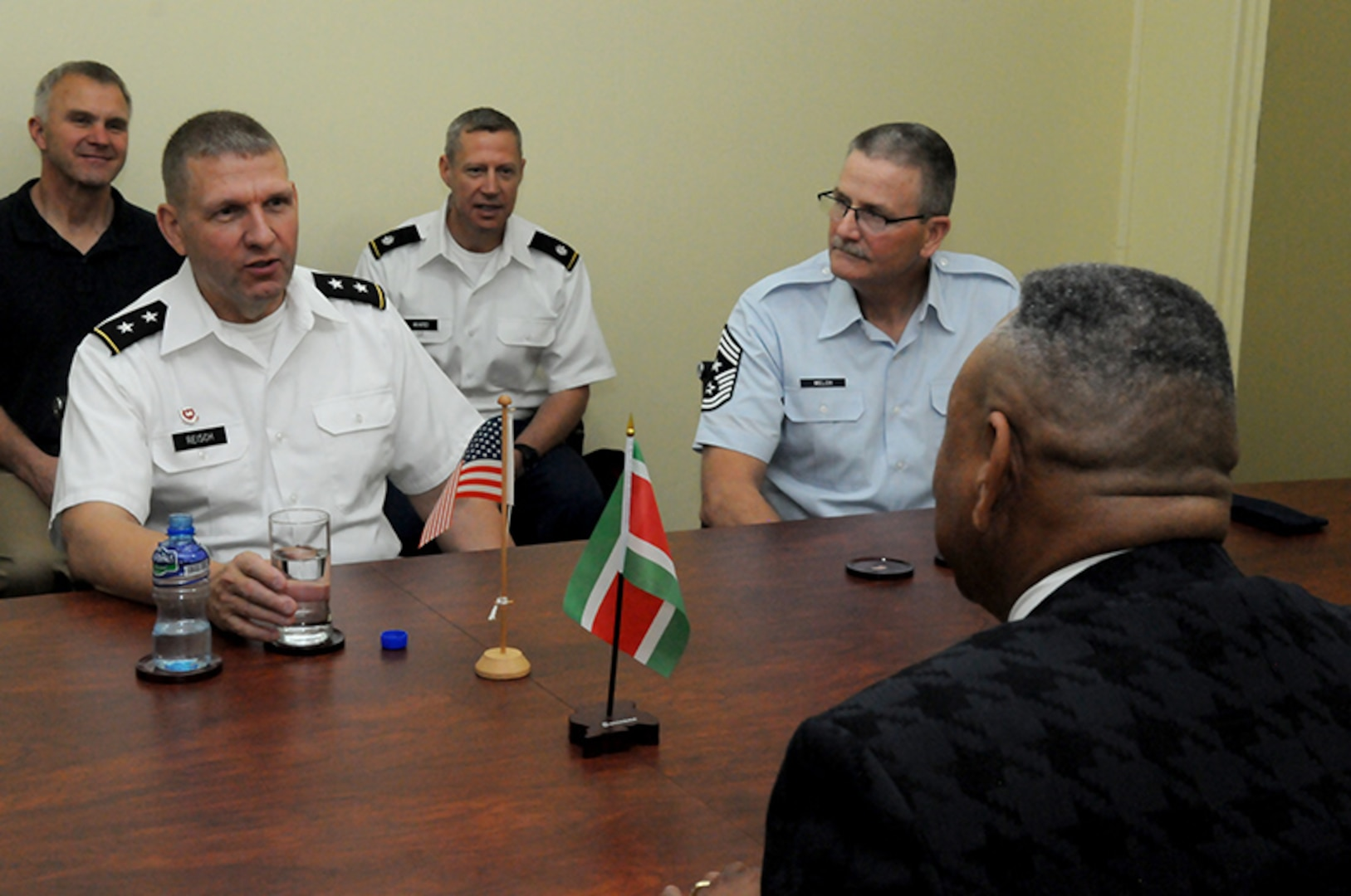 U.S. Army Maj. Gen. Tim Reisch, adjutant general for the South Dakota National Guard and State Command Chief Master Sgt. James Welch, SDNG senior enlisted leader, meet with Suriname's Minister of Defense Ronni Benschop, during a distinguished leaders visit to Paramaribo, Suriname, Nov. 25, 2015.