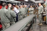 Members of the 87th Logistics Readiness Support Group from MaGuire Air Force Base, N.J., tour the Eastern Distribution Center, the Department of Defense's largest warehouse, during their Dec. 3 visit to DLA Distribution Headquarters.
