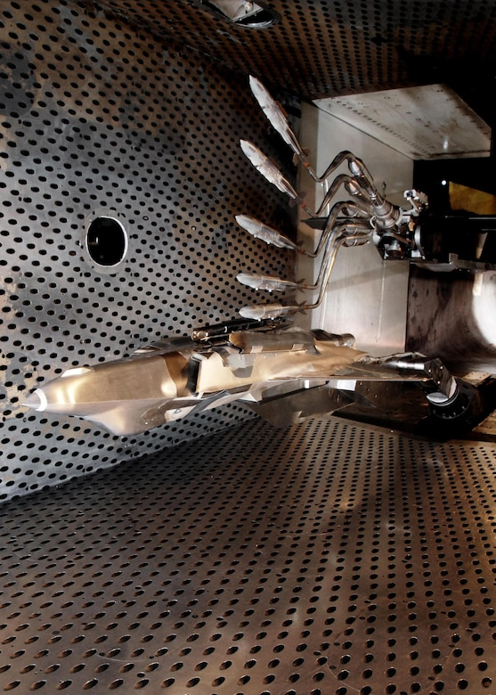 Initial weapon integration testing for the F-35 was conducted at the Arnold Engineering Development Complex. Pictured here are multiple exposures of a Guided Bomb Unit-31 Joint Direct Attack Munition, separating from the F-35 Lightning II aircraft in the 4-foot transonic wind tunnel during testing at AEDC in 2007. (Courtesy photo/Rick Goodfriend)