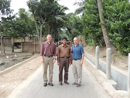 From left to right, Randy Bowker, chief of Programs and Project Management Division, U.S. Army Corps of Engineers-Alaska District; Md. Abu Shahriar, Local Government Engineering Department of Bangladesh district engineer for the Jessore District; and Col. Michael Brooks, commander of the U.S. Army Corps of Engineers-Alaska District, pose for a picture in early October after examining one of eight recently constructed roads in Jessore, Bangladesh. The Alaska District, in collaboration with the U.S. Agency for International Development and the Local Government Engineering Department of Bangladesh, completed the roads in the first government-to-government agreement in the country. The roads are instrumental in helping local farmers get their crops to the market, children get to school easier and facilitating families' access to medical clinics, thus increasing the quality of life for the people of the region.