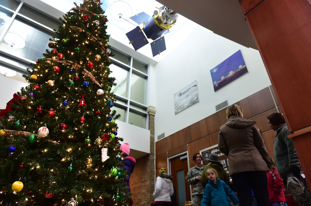 Team Buckley held an annual tree-lighting ceremony Dec. 2, 2015, on Buckley Air Force Base, Colo. Members of Team Buckley gathered to celebrate and enjoy refreshments in honor of the holiday season. (U.S. Air Force photo by Airman 1st Class Luke W. Nowakowski/Released)