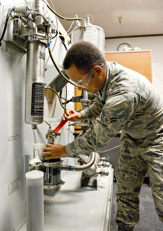 Airman 1st Class Toris Richardson services a liquid cooling system on one of the training modules at the 373rd Training Reserve Squadron. (Air Force photo by Kelly White/Released)