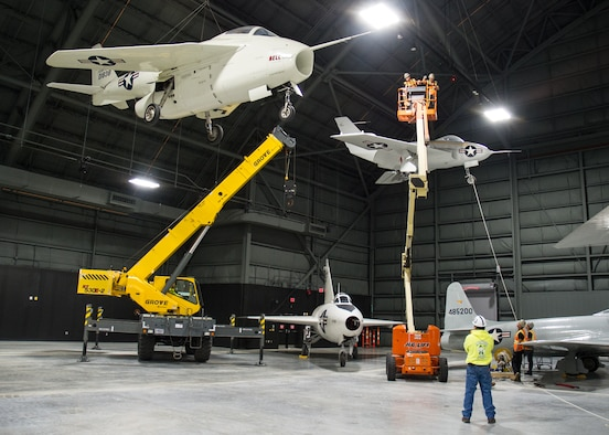 Restoration staff move R&D aircraft into position within the new fourth building at the National Museum of the U.S. Air Force in November 2015. (U.S. Air Force photo)