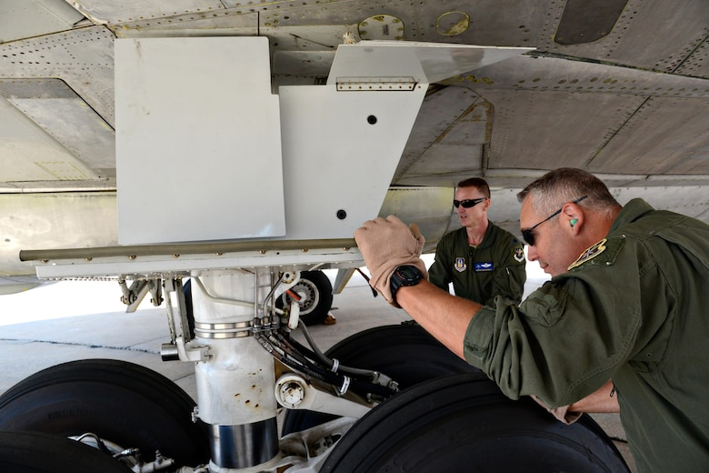 Lt. Col. Brian Rhodarmer and Senior Master Sgt. Tim Brown inspect flight controls on an E-3 AWACS, looking for any kind of leaks or for any components that may not be hooked up properly. (Air Force photo by Kelly White)