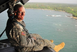 Richard Dabal, a physical scientist, in a Chinook helicopter off the coast of Liberia (West Africa) on New Year's Eve 2014. He was heading home after a 3-month deployment to Liberia fighting the Ebola virus.