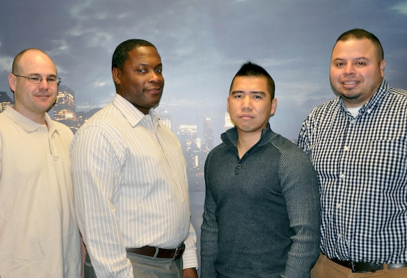 Logistics Management personnel take time out for a photo. From left to right: James Gains, Allen Crenshaw, Fen Chen, and Andres Garcia. Logistics Management oversees the New York District's fleet of vehicles; building maintenance and renovations; investigates property loss; and now implementing Presidential Executive Order 13963 by creating a Vehicle Utilization Review Board (VURB) to reduce fuel consumption.