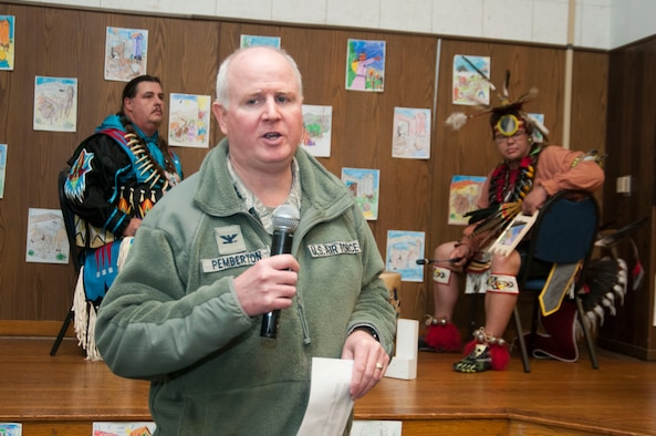 "Col. Thomas ""Thom"" Pemberton, 459th Operations Group commander and host for the Native American Heritage Month culmination celebration, provides opening remarks for the event in the 459th Air Refueling Wing auditorium Nov. 30, 2015. This year's event included traditional food tasting, books, beadwork, weaponry, music and dancing from half a dozen Native American tribes. (U.S. Air Force photo by Staff Sgt. Kat Justen)"