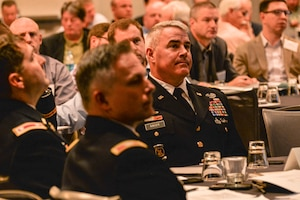 BG Kaiser listening to LTC Michael Sellers address the USACE Construction & Contracting Personnel and representatives from the Construction Contractors at the 2015 Construction Roundtable.