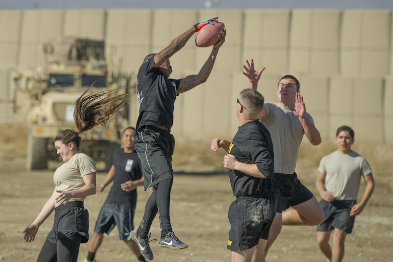 "Members of Florida Army National Guard's 1st Battalion, 265th Air Defense Artillery Regiment play members from Florida Air National Guard's 290th Joint Communications Support Squadron in a friendly ""Turkey Bowl"" football game at Bagram Airfield, Afghanistan, Nov. 26, 2015. The Army National Guard team won the game 42-35. The 1-265th is from Palm Coast, Fla., and the 290th JCSS are stationed at MacDill Air Force Base, Fla."