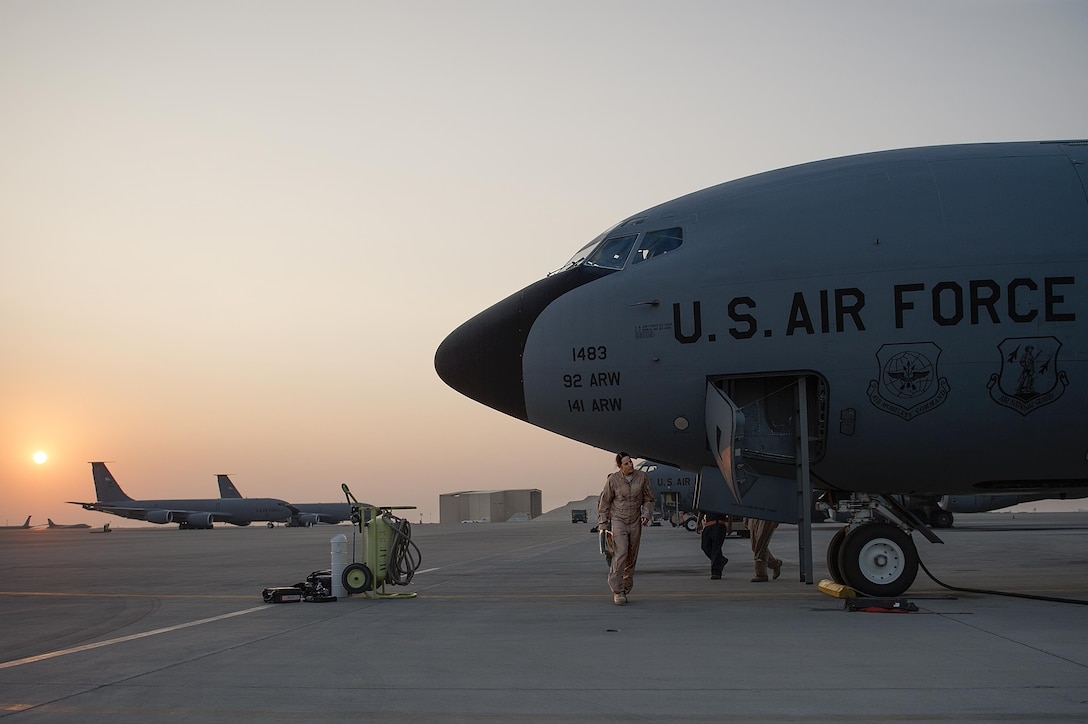 Members from the 340th Expeditionary Air Refueling Squadron perform prefight checks before leaving to refuel F-16 Fighting Falcons from the Royal Norwegian Air Force and the Republic of Singapore air force over Southwest Asia in support of Operation Inherent Resolve Dec.1, 2015. OIR is the coalition intervention against the Islamic State of Iraq and the Levant. (U.S. Air Force photo/Tech. Sgt. Nathan Lipscomb)