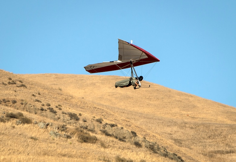 "Staff Sgt. Tevni Carrillo, a 9th Air Refueling Squadron KC-10 Extender flight engineer, glides just after takeoff from a 150-foot gliding point at Ed R. Levin County Park, Calif., Sept. 9, 2015. Carrillo's experience as a flight engineer and crew chief has opened his mind up to the idea of piloting a hang glider of his own. This photo is from the latest Airman Magazine feature story ""Hang in there."" To see more: http://airman.dodlive.mil/2015/11/hang-in-there/#sthash.LhbcQgss.dpuf. (U.S. Air Force photo/Staff Sgt. Vernon Young Jr.)"