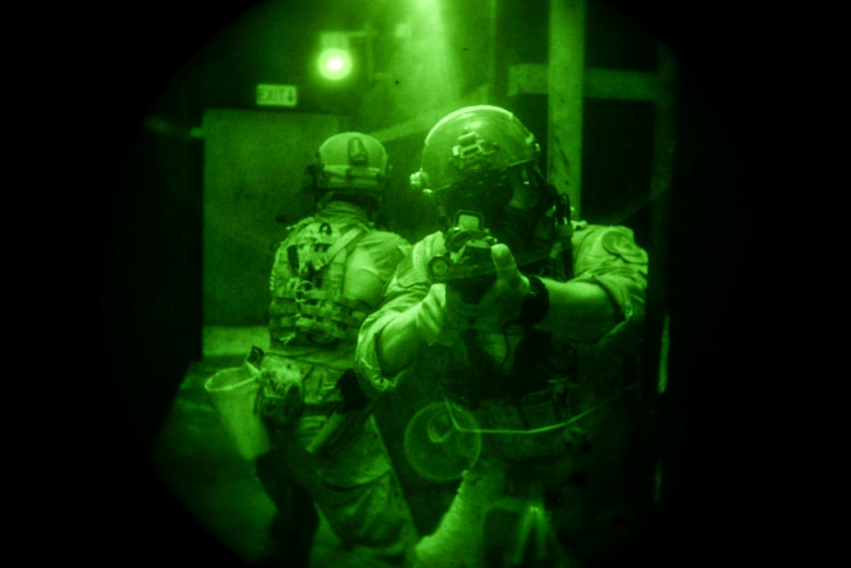 Airmen from the 320th Special Tactics Squadron clear a hallway Nov. 19, 2015, in a shoot house at Camp Hansen, Japan. The Airmen cleared the house as part of training led by the Direct Action Resource Center during a two-week course where a group of pararescuemen, combat controllers and force reconnaissance Marines develop skills they can use when they deploy with other joint special operations teams. (U.S. Air Force photo/Senior Airman John Linzmeier)