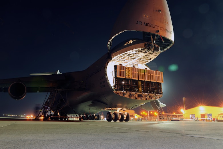 The 728th Air Mobility Squadron prepares to offload a C-5M Super Galaxy Nov. 12, 2015, at Incirlik Air Base, Turkey. The C-5 is one of the many aircraft being utilized by the U.S. Air Force to deliver personnel and cargo to Incirlik AB in support of Operation Inherent Resolve. (U.S Air Force photo/Airman 1st Class Daniel Lile)