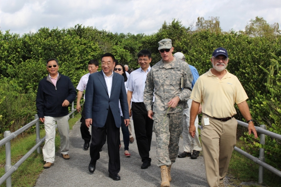Thomas Teets, Director of the Office of Everglades Policy and Coordination of the South Florida Water Management District, Jacksonville District Commander Col. Jason Kirk, Water Resources Minister Chen Lei (front, right to left) and members of the Chinese delegation head to the observation tower during a tour of Shark Valley in Everglades National Park.