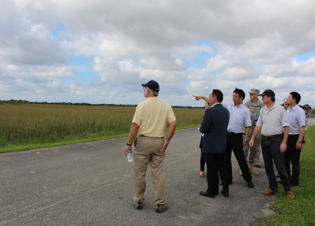 The group observes the classic ridge and slough landscape of the Everglades, with sawgrass and tree islands, during their visit to Shark Valley in Everglades National Park.