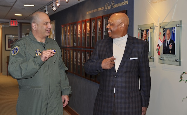 Maj. Gen. Richard S. Haddad, Air Force Reserve Command vice commander and Mr. John Grant, Air Force Reserve Celebration Bowl executive director, take a tour of the headquarters prior to meeting to discuss the upcoming bowl game. The Air Force Reserve will be the title sponsor for the Air Force Reserve Celebration Bowl, slated for Dec. 19 at the Georgia Dome in Atlanta. (Air Force photo/Master Sgt Chance Babin)