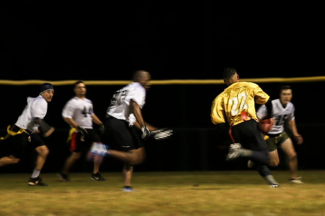 A Marine eludes tacklers during the 2015 Marine Corps Air Station Beaufort Intramural Football Tournament aboard the air station Nov. 23. The tournament, hosted by Marine Corps Community Services South Carolina, is a flag football league made of 13 teams of Marines from different units aboard the air station.