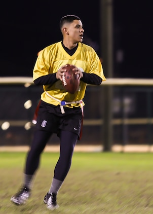 A Marine drops back for a pass during the 2015 Marine Corps Air Station Beaufort Intramural Football Tournament aboard the air station Nov. 23. The tournament, hosted by Marine Corps Community Services, is a flag football league made of 13 teams of Marines from different units aboard the air station.