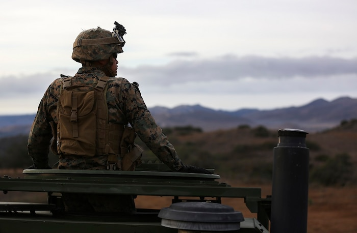 Corporal Christan Curz observes a High-Mobility Artillery Rocket System fire in support of Steel Knight aboard Marine Corps Base Camp Pendleton, Calif., Dec. 4, 2015. Steel Knight is a 1st Marine Division led exercise which enables the Marines and sailors to operate in a realistic combined-arms environment to develop skill sets necessary to operate as a fully capable Marine Air Ground Task Force. Curz is an artilleryman assigned to Battery Q, 5th Battalion, 11th Marine Regiment, 1st Marine Division.