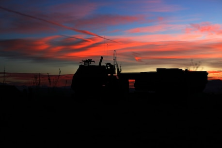 Marines wait to fire a High-Mobility Artillery Rocket System in support of Steel Knight aboard Marine Corps Base Camp Pendleton, Calif., Dec. 4, 2015. Steel Knight is a 1st Marine Division led exercise which enables the Marines and sailors to operate in a realistic combined-arms environment to develop skill sets necessary to operate as a fully capable Marine Air Ground Task Force. The Marines are assigned to Battery Q, 5th Battalion, 11th Marine Regiment, 1st Mar. Div.