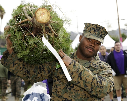 Camp Pendleton hosts their annual Trees for Troops event, December 4. Camp Pendleton, in conjunction with several civilian agencies, aims to bring a fresh Christmas tree to every family who wants one free of charge.