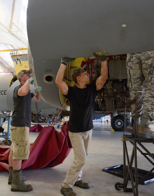 Senior Airman Josh Hines and Senior Airman Adrian Condit, crew chiefs from